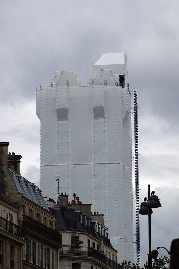 Chatelet tower in Paris, France shrouded in white fabric.