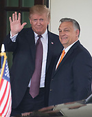 United States President Donald J. Trump waves to the media as he welcomes Prime Minister Viktor Orban of Hungary to the White House in Washington, DC on Monday, May 13, 2019.  The two leaders will meet for about an hour.<br /> Credit: Ron Sachs / CNP