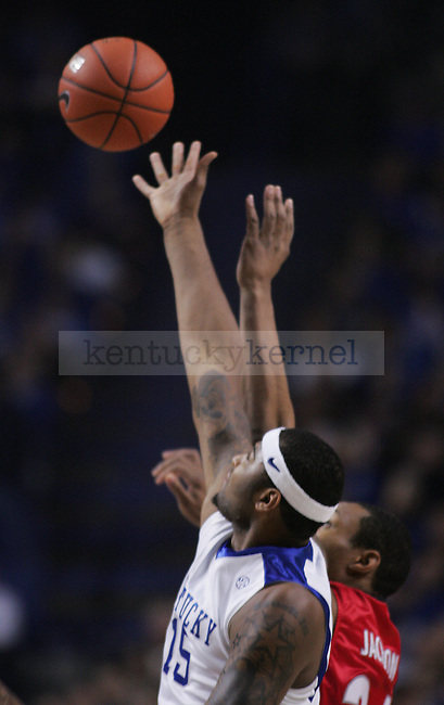 Freshman forward DeMarcus Cousins tips off the bal for UK during the UK men's basketball game against Georgia at Rupp Arena on Saturday, Jan. 9, 2010. The Cats were down 35-34 to the Bulldogs at halftime. Photo by Adam Wolffbrandt | Staff