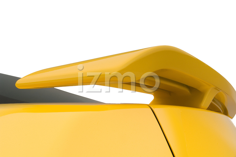 Rear spoiler detail of a yellow 2006 Ford Mustang Coupe
