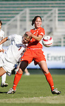 Florida State's Viola Odebrecht (l) heads the ball away from Clemson's Amber Funk (r) on Wednesday, November 2nd, 2005 at SAS Stadium in Cary, North Carolina. The Florida State University Seminoles defeated the Clemson University Tigers 4-0 during their Atlantic Coast Conference Tournament Quarterfinal game.