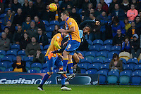 Mansfield Town's Lee Collins wins a header from Wycombe Wanderers Aaron Amadi-Holloway during the Sky Bet League 2 match between Mansfield Town and Wycombe Wanderers at the One Call Stadium, Mansfield, England on 31 October 2015. Photo by Garry Griffiths.
