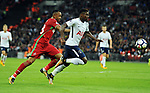 Serge Aurier of Tottenham Hotspur is challenged by Jordan Ayew of Swansea City late in the 2nd half and Referee Michael Dean waved play on during the premier league match at the Wembley Stadium, London. Picture date 16th September 2017. Picture credit should read: Robin Parker/Sportimage