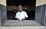 A student in the Southern Sudanese village of Jombo poses in the window of a classroom in a new village school constructed by the United Methodist Committee on Relief (UMCOR). Families here are rebuilding their lives after returning from refuge in Uganda. NOTE: In July 2011, Southern Sudan became the independent country of South Sudan