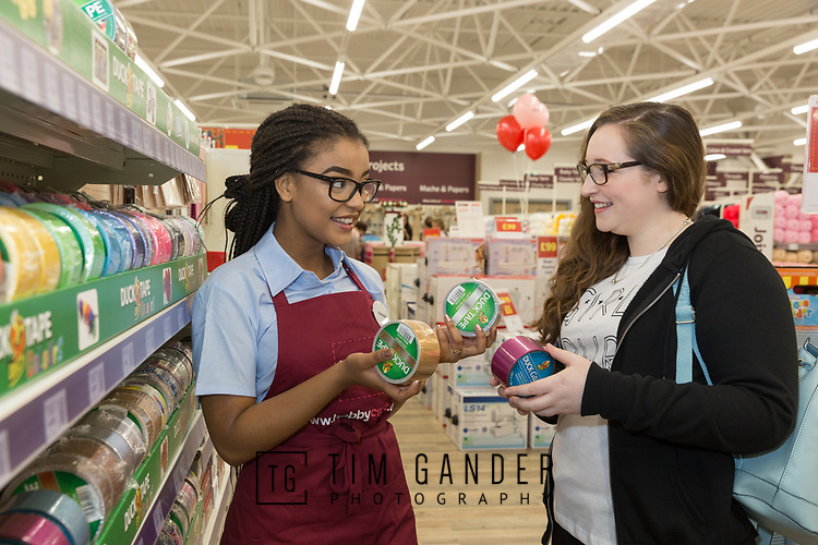 15/07/2017 Hobbycraft opens a new store at Mero Retail Park on Lower Bristol Road, Bath.<br /> <br /> Store colleague Natalie Jackson helps Clarice Bailey from Bath with choosing the right tape.