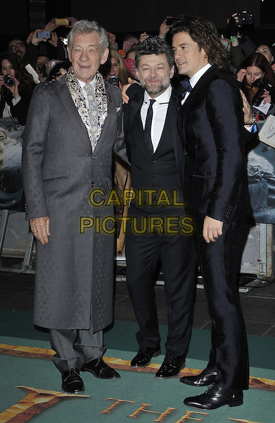 LONDON, ENGLAND - DECEMBER 01: Sir Ian McKellen, Andy Serkis &amp; Orlando Bloom attend the &quot;The Hobbit: The Battle of the Five Armies&quot; world film premiere, Odeon Leicester Square cinema, Leicester Square, on Monday December 01, 2014 in London, England, UK. <br /> CAP/CAN<br /> &copy;Can Nguyen/Capital Pictures