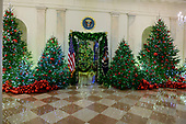 "The 2018 White House Christmas decorations, with the theme ""American Treasures"" which were personally selected by first lady Melania Trump, are previewed for the press in Washington, DC on Monday, November 26, 2018.  This view is looking from the Grand Foyer towards the Blue Room.<br /> Credit: Ron Sachs / CNP"
