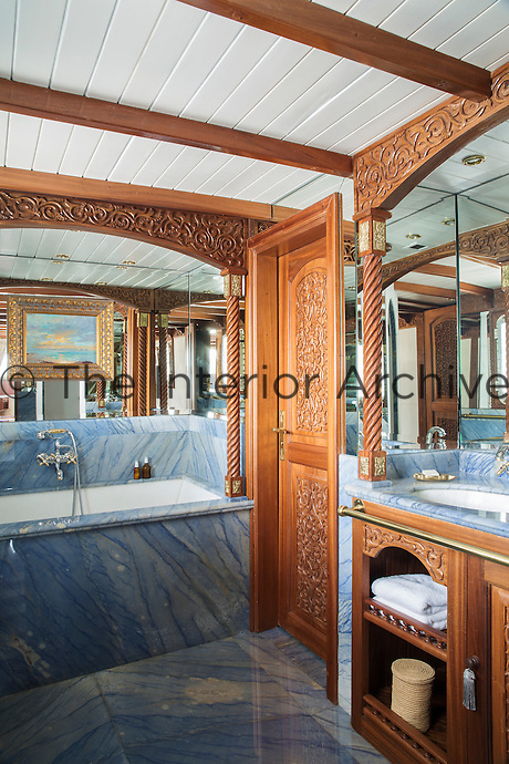 One of seven bathrooms on board La Sultana.  Each is clad in a different marble and features carved wood panelling and onyx bathroom fittings