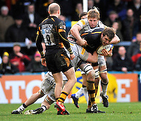 High Wycombe, England. Joe Launchbury of London Wasps tackled during the Aviva Premiership match between London Wasps and Sale Sharks at Adams Park on December 23. 2012 in High Wycombe, England.