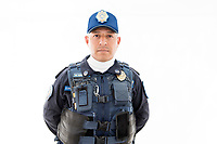 Julio Cesar Romero Ramirez, policeman. Model release #31.  Moving Portraits, Monumento a la Revolucion, Mexico City, Mexico