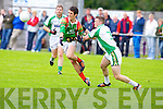 St Micheal's/Foilmore Eanna O'Connor gets his pass away against St Brendan's Rory Horgan in the Kerry senior football championship at Blennerville on Saturday.