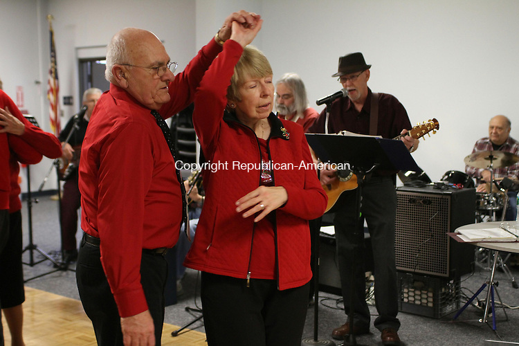 TORRINGTON, CT, 10 December 2014-121014LW01 - Armand Roy, 75, and his wife, Diane Roy, 66, dance to The Tune Dusters at the Sullivan Senior Center in Torrington Wednesday. Like many baby boomers, Diane Roy said she likes to keep active. Laraine Weschler Republican-American