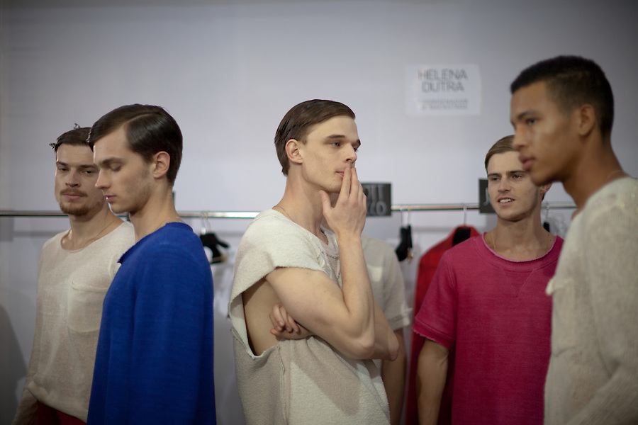 Models wait for line-up backstage for the Brazilian brand, Osklen, at São Paulo Fashion Week for Summer Season 2013/2014, at Bienal, in Ibirapuera Park, São Paulo, Brazil, on Thursday, March 21, 2013.