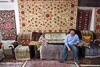 Uzbekistan, Samarqand.<br /> Silk carpet manufacture. Mr. Abdullah, manager.