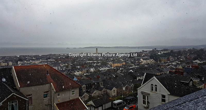 Snow falls over roof tops in the Mount Pleasant area of Swansea, overlooking the nearby village of Mumbles in Wales, UK. Sunday 10 December 2017