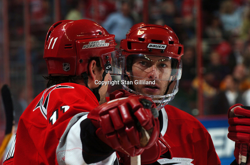 Carolina Hurricanes' teammates Justin Williams (11) and Matt Cullen discuss their game with the Boston Bruins at the RBC Center in Raleigh, NC Wednesday, March 1, 2006. The Hurricanes won 4-3...