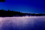 Morning mist and kayers on the lake at Kripalu Institute, Lenox Mass.
