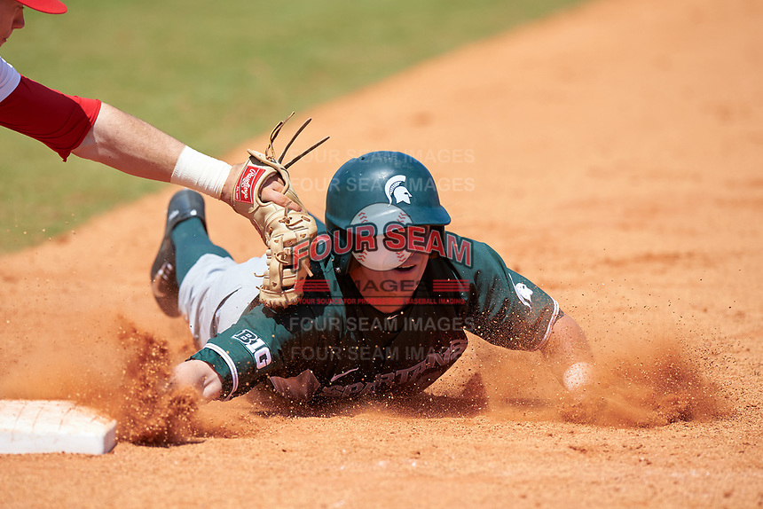 Michigan State Spartans pinch runner Dan Chmielewski (21) dives back to first base during a game against the Illinois State Redbirds on March 8, 2016 at North Charlotte Regional Park in Port Charlotte, Florida.  Michigan State defeated Illinois State 15-0.  (Mike Janes/Four Seam Images)