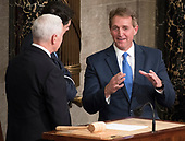 United States Senator Jeff Flake (Republican of Arizona), right,has a conversation with US Vice President Mike Pence and Speaker of the United States House of Representatives Paul Ryan (Republican of Wisconsin) on the rostrum prior to the arrival of US President Donald J. Trump who will deliver his first State of the Union address to a joint session of the US Congress in the US House chamber in the US Capitol in Washington, DC on Tuesday, January 30, 2018.<br /> Credit: Ron Sachs / CNP