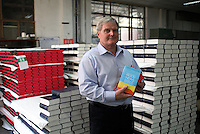 Peter Dean, UBS consultant and factory manager holding copies of the Collins Bible at Amity Printing Co in Nanjing, 03 Dec 2007,  which is a joint venture with the United Bible Society that produces millions of bibles annually.<br />
