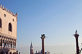 ITALY, Venice.  A view of Doge's Palace on the left and the Columns of the Lion and San Teodoro on the right at the Piazza San Marco. The island of San Giorgio Maggiore can be seen in the distance, dominated by the tower and dome of the Church of San Giorgio Maggiore.