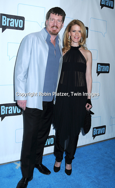 "Simon van Kempen and Alex McCord of ""The Real Housewives of NYC"" posing for photographers at The Bravo Upfront  Party on March 10, 2010 at Skylight Studios in New York City."
