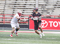 College Park, MD - April 15, 2018: Rutgers Scarlet Knights Jules Heninburg (7) looks to pass the ball during game between Rutgers and Maryland at  Capital One Field at Maryland Stadium in College Park, MD.  (Photo by Elliott Brown/Media Images International)