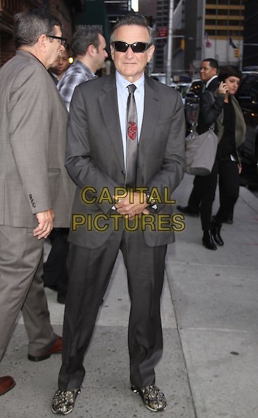Robin Williams<br /> at the Ed Sullivan Theater for an appearance on Late Show with David Letterman in New York City, USA.<br /> September 25th, 2013 <br /> full length grey gray suit sunglasses shades <br /> CAP/MPC/RW<br /> &copy;RW/ MediaPunch/Capital Pictures