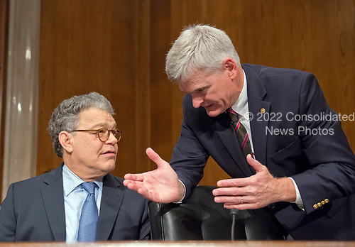 United States Senators Al Franken (Democrat of Minnesota), left, and Bill Cassidy (Republican of Louisiana) in discussion prior to the start of the US Senate Committee on Health, Education, Labor, and Pensions meeting on Capitol Hill in Washington, DC on Thursday, July 13, 2007<br /> Credit: Ron Sachs / CNP