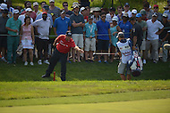 Bethesda, MD - June 29, 2014: Patrick Reed prepares for his shot after his ball landed in a  water ditch during the Final Round of the Quicken Loans National at the Congressional Country Club in Bethesda, MD, June, 29, 2014. Reed double-bogeyed after sitting atop the Leaderboard at the start of the round. (Photo by Don Baxter/Media Images International)