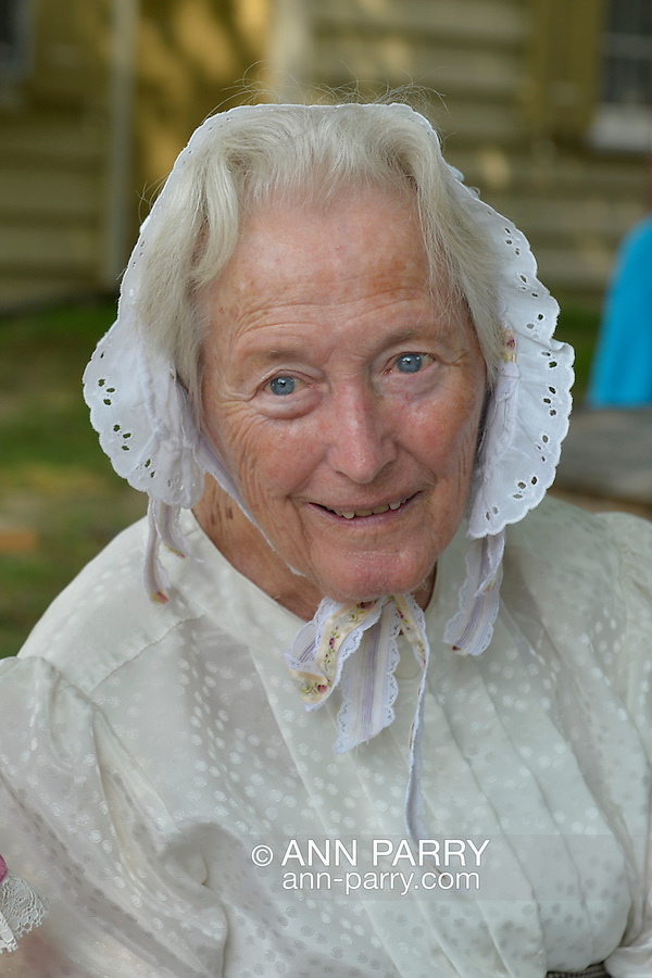 Old Bethpage, New York, USA. August 30, 2015. JULIETTE FOX of Hicksville, wearing Civil War era style clothing, is a member of the Old Bethpage Village Dancers which danced throughout the Old Time Music Weekend at Old Bethpage Village Restoration, where popular music of the American Civil War period was performed, and visitors learned traditional 1800's contradances.
