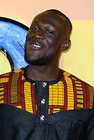LONDON, ENGLAND - FEBRUARY 8: Stormzy arrives at the 'Black Panther' European premiere at the Eventim Apollo, on February 8th, 2018 in London, England. <br /> CAP/JC<br /> &copy;JC/Capital Pictures