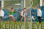Rathmore keeper Padraic McCarthy keeps the ball safe from Foilmore's Eanna O'Connor during their Club Championship semi final in Killorglin on Saturday