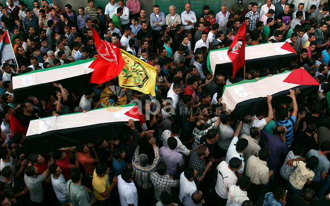 Palestinians carry a flag-drapped coffin in the West Bank town of Nablus, 31 May 2012, with the remains of some of the 90 Palestinian militants Israel handed over to the Palestinian Authority, stating it hoped the 'goodwill gesture' would help restart peace talks. Exhumed from enemy cemeteries in Israel, 79 remains were transported to the central West Bank city of Ramallah and 12 to the Gaza Strip, for reburial in their respective hometowns. Photo by Wagdi Eshtayah