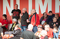 Fleetwood Town fan watch their team in action<br /> <br /> Photographer Andrew Vaughan/CameraSport<br /> <br /> The EFL Sky Bet League One - Lincoln City v Fleetwood Town - Saturday 31st August 2019 - Sincil Bank - Lincoln<br /> <br /> World Copyright © 2019 CameraSport. All rights reserved. 43 Linden Ave. Countesthorpe. Leicester. England. LE8 5PG - Tel: +44 (0) 116 277 4147 - admin@camerasport.com - www.camerasport.com
