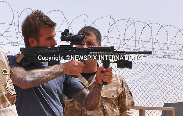 "DAVID BECKHAM_takes aim.David Beckham paid a surprise goodwill visit to UK and US troops in Camp Bastion. He met with hundreds of soldiers and gave away signed England shirts and memorabilia. He was, he said, 'overwhelmed' by the stories of courage he heard..Beckham arrived on Friday night on a Royal Air Force C17 aircraft, stepping off into 45 degree heat in body armour and helmet..After a night's sleep, he ate breakfast in the cookhouse, moving from table to table signing autographs and having photographs taken_Camp Bastion, Helmand Province, Afghanistan_22/05/2010.Photo Credit: ©LLoyd_Newspix International..**ALL FEES PAYABLE TO: ""NEWSPIX INTERNATIONAL""**..PHOTO CREDIT MANDATORY!!: NEWSPIX INTERNATIONAL..IMMEDIATE CONFIRMATION OF USAGE REQUIRED:.Newspix International, 31 Chinnery Hill, Bishop's Stortford, ENGLAND CM23 3PS.Tel:+441279 324672  ; Fax: +441279656877.Mobile:  0777568 1153.e-mail: info@newspixinternational.co.uk"