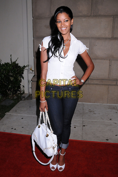 CLAUDIA JORDAN.In Touch Weekly's Summer Stars Party 2008 at Social Hollywood, Hollywood, California, USA..May 22nd, 2008.full length white top bag purse jeans denim rolled turned up hand on hip.CAP/ADM/BP.©Byron Purvis/AdMedia/Capital Pictures.