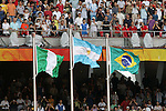 23 August 2008: The flags are raised during the medal ceremony - Argentina (center) won gold, Nigeria (left) won silver, and Brazil (right) won bronze. The Medal Ceremony for the Men's Olympic Football Tournament was held at the National Stadium in Beijing, China after the Gold Medal match.