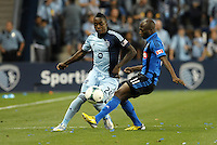 KANSAS CITY, KS - June 1, 2013:<br />  Mechack Jerome (24) defender Sporting KC , Sanna Nyassi (11) midfield Montreal Impact <br /> Montreal Impact defeated Sporting Kansas City 2-1 at Sporting Park.
