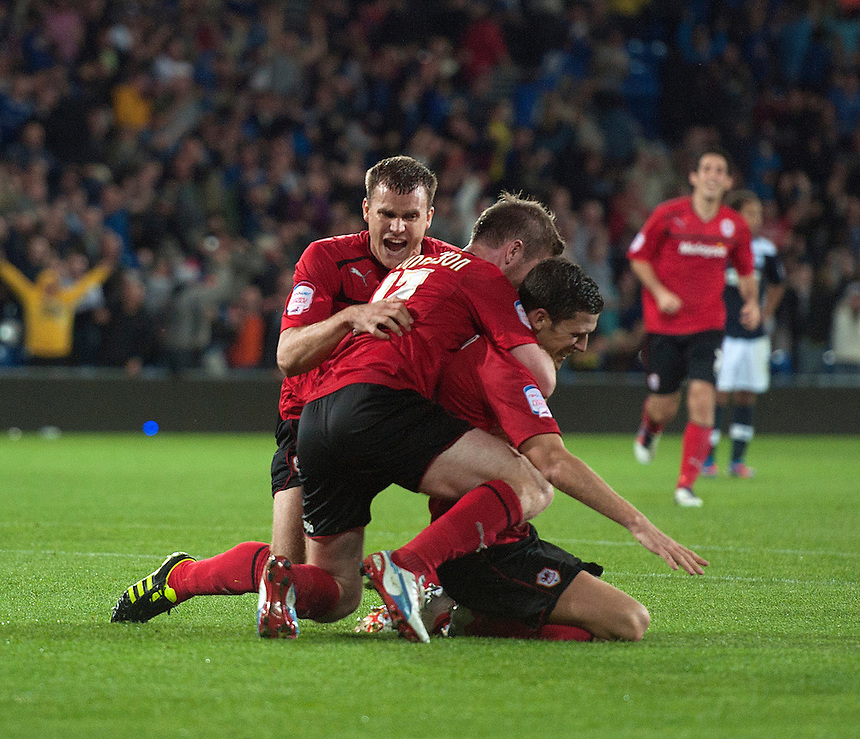 Cardiff City's Mark Hudson celebrates scoring the only goal of the game late into the second half with team-mates. Aron Gunnarsson and Ben Turner ..Football - npower Football League Championship - Cardiff City v Huddersfield Town - Friday 17th August 2012 - Cardiff City Stadium - Cardiff..