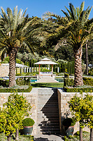 In the centre of the gardens, steps lead up to a gazebo which overlooks the pool.