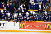 ?, Mark Osiecki (USA - Assistant Coach), Jake Gardiner (USA - 28), Matt Donovan (USA - 4), Philip McRae (USA - 9), Brock Bradley (USA - Manager), Kyle Palmieri (USA - 23), Jeremy Morin (USA - 26), Dean Blais (USA - Head Coach), AJ Jenks (USA - 22), Tom Ward (USA - Assistant Coach) - Team Canada defeated Team USA 5-4 (SO) on Thursday, December 31, 2009, at the Credit Union Centre in Saskatoon, Saskatchewan, during the 2010 World Juniors tournament.