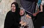 Relatives of four Palestinian children from the Baker family, whom medics said were killed by a shell fired by an Israeli naval gunboat, mourn during their funeral in Gaza City July 16, 2014. Four Palestinian children were killed and one was critically wounded on a Gaza beach on Wednesday by the shell fired by the Israeli naval gunboat, a Palestinian health official said. Asked about the incident, an Israeli military spokesman in Tel Aviv said he was checking the report. Gaza health officials said 213 Palestinians, most of them civilians, had been killed in air and naval barrages, in the worst flareup of Israeli-Palestinian violence in two years. One Israeli has been killed by shelling from Gaza that has made a race to shelter a daily routine for hundreds of thousands in Israel. Photo by Ashraf Amra