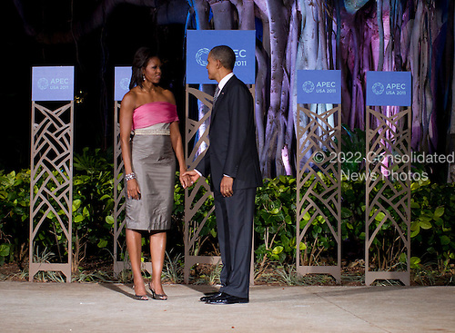 United States President Barack Obama and First Lady Michelle Obama pose wait to greet guests before the Asia-Pacific Economic Cooperation (APEC) summit dinner at the Hale Koa Hotel in Honolulu, Hawaii on Saturday, November 12, 2011..Credit: Kent Nishimura / Pool via CNP