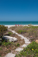Stepping stones lead to white, sandy beach along Gulf of Mexico at Captiva Island, Florida, USA. Photo by Debi PIttman Wilkey