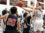 Naugatuck, CT-29 December 2011-122911CM11-  Naugatuck's  Nate Franklin passes around Pomperaug's Nathan Rubinstein during a non-league match-up against Pomperaug in Naugatuck Thursday night.  Pomperaug was too tough for Naugy and took home the win, 67-57.   Christopher Massa Republican-American