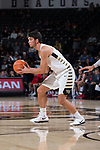 Troy Rike (45) of the Wake Forest Demon Deacons looks to pass the ball during second half action against the Richmond Spiders at the LJVM Coliseum on December 2, 2017 in Winston-Salem, North Carolina.  The Demon Deacons defeated the Spiders 82-53.  (Brian Westerholt/Sports On Film)