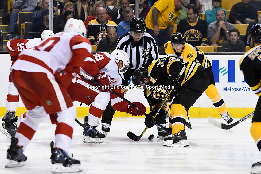 Monday, September 28, 2015, Boston, MA -  Detroit Red Wings center Joakim Andersson (18) and Boston Bruins center Patrice Bergeron (37) battle during a faceoff during the NHL game between the Detroit Red Wings and the Boston Bruins held at TD Garden, in Boston, Massachusetts. The Red Wings defeat the Bruins 3-1 in regulations time. Eric Canha/CSM