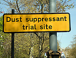 Yellow dust suppressant trial site road sign, the Embankment, London