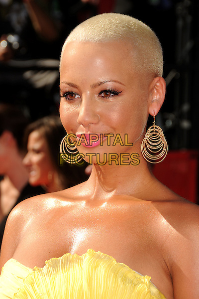 AMBER ROSE.18th Annual ESPY Awards - Arrivals held at Nokia Theatre L.A. Live, Los Angeles, California, USA..July 14th, 2010.espys headshot portrait shaved bleach blonde hair head gold hoops hoop earrings pink lipstick make-up yellow strapless  .CAP/ADM/BP.©Byron Purvis/AdMedia/Capital Pictures.